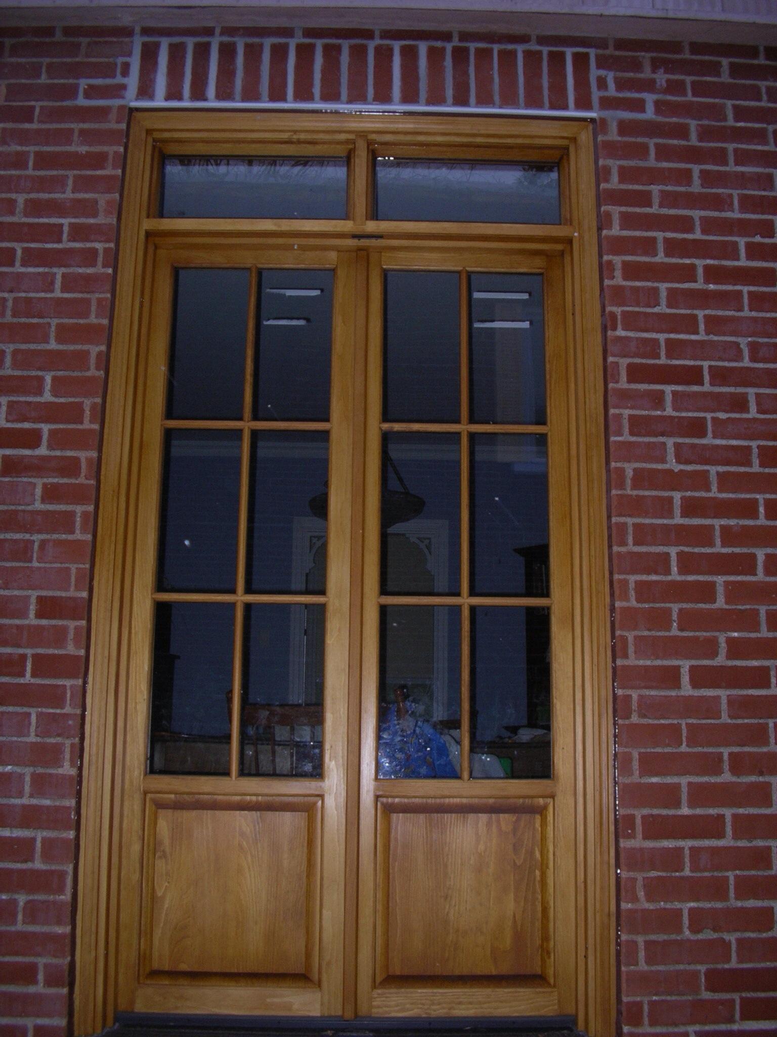 Porte balcon en bois menuiserie delisle for Fenetre thermos